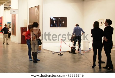 MILAN - MARCH 27: People visit work of arts galleries during MiArt ArtNow, international exhibition of modern and contemporary art March 27, 2010 in Milan, Italy. - stock photo