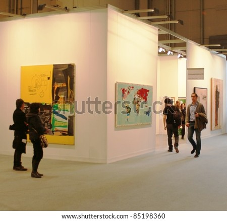 MILAN - MARCH 27: People walk through paintings and sculptures work of arts galleries during MiArt ArtNow, international exhibition of modern and contemporary art March 27, 2010 in Milan, Italy.