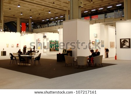 MILAN - MARCH 27: People walk through work of arts galleries during MiArt ArtNow, international exhibition of modern and contemporary art March 27, 2010 in Milan, Italy. - stock photo