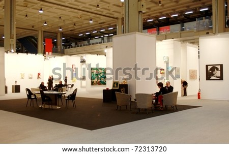 MILAN - MARCH 27: People walk through works of art galleries during MiArt ArtNow, international exhibition of modern and contemporary art March 27, 2010 in Milan, Italy.
