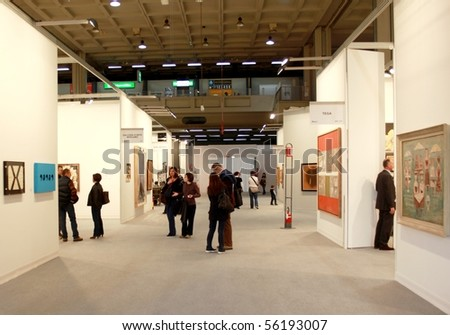 MILAN - MARCH 27: People walk trough work of arts galleries during MiArt ArtNow, international exhibition of modern and contemporary art March 27, 2010 in Milan, Italy. - stock photo