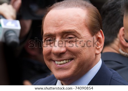 MILAN - MARCH 28: Silvio Berlusconi greets the crowd few minutes after the first appearance for Mediatrade trial on March 28, 2011 in Milan, Italy.