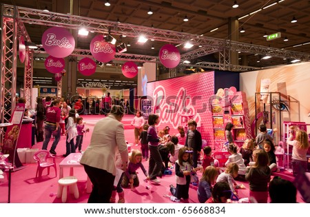 MILAN - NOV 21: Barbie stand at G! Come Giocare 2010, International Toy Fair, in Milan Fair, Nov 21, 2010. - stock photo