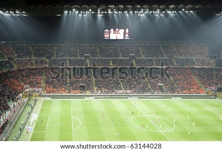 MILAN- OCTOBER 16: Crowd of supporters at Italian Championship soccer game, AC Milan - Chievo on October 16, 2010 in Milan - stock photo