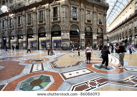 MILAN - OCTOBER 6: Vittorio Emmanuele II shopping gallery on October 6, 2010 in Milan, Italy. Inaugurated in 1865, the gallery claims to be the oldest shopping center worldwide. - stock photo