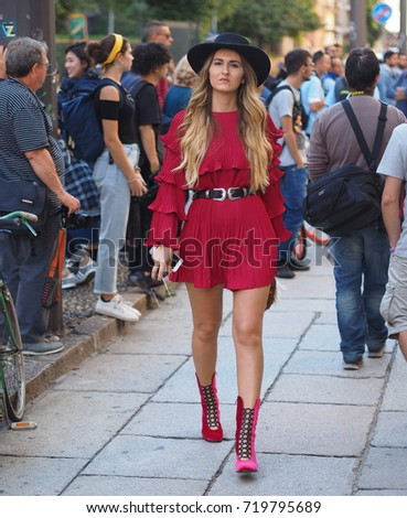 MILAN - SEPTEMBER 21: A fashionable woman after VIVETTA fashion show, during Milan Fashion Week spring/summer 2018 on September 21, 2017 in Milan.