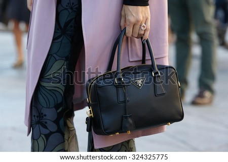 MILAN - SEPTEMBER 24: Black Prada bag seen before Cristiano Burani show during Milan Fashion Week Day 2, Spring / Summer 2016 street style on September 24, 2015 in Milan. - stock photo