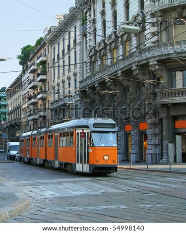 Milan street with old orange tram, Italy - stock photo