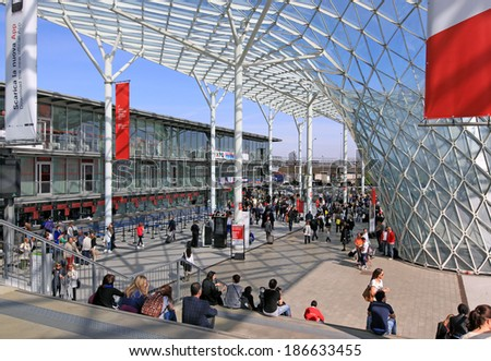 MILANO - APRIL 10, 2014: People arriving at Salone del Mobile, international home furnishing and accessories design exhibition in Milano, Italy.  - stock photo