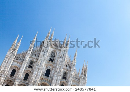 MILANO, ITALY - APRIL 16: Milan Cathedral from the Square on April 16, 2014. The Gothic cathedral took nearly six centuries to complete. It is the fifth largest cathedral in the world. - stock photo