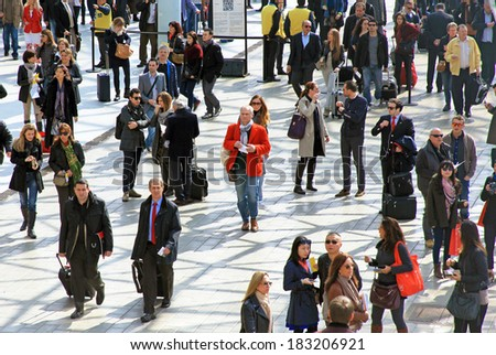 MILANO, ITALY - APRIL 10, 2013: People crowd enter Salone del Mobile, international furnishing accessories exhibition at Rho Fiera Center in Milano, Italy.  - stock photo