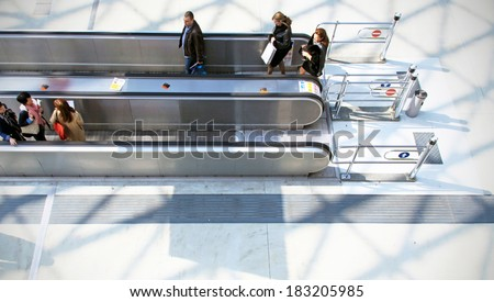 MILANO, ITALY - APRIL 10, 2013: People on the tapis roulant enter Salone del Mobile, international furnishing accessories exhibition at Rho Fiera Center in Milano, Italy.  - stock photo