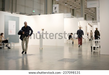 MILANO, ITALY - APRIL 07, 2013: People visit paintings galleries at MiArt, international exhibition of modern and contemporary art in Milano, Italy. - stock photo