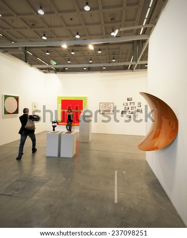 MILANO, ITALY - APRIL 07, 2013: Taking photos at galleries during MiArt, international exhibition of modern and contemporary art in Milano, Italy. - stock photo