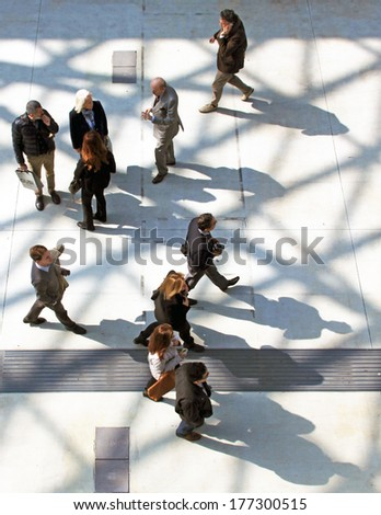MILANO, ITALY - APRIL 10, 2013: View of people walking to the entrance of Salone del Mobile, international furnishing accessories exhibition at Rho Fiera Center in Milano, Italy. - stock photo