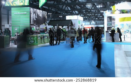 MILANO, ITALY - FEBRUARY 12, 2015: People visit tourism exhibition stands area at BIT, International Tourism Exchange Exhibition in Milano, Italy. - stock photo