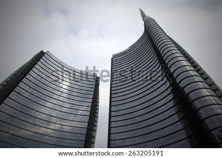 MILANO, ITALY - MARCH 21, 2015: View of Unicredit Tower at new Porta Nuova area in Milano. The restructuring of this area is an ambitious project in the city of Milan in anticipation of Expo 2015. - stock photo