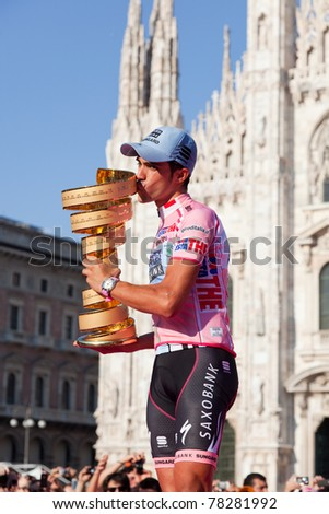 MILANO, ITALY - MAY 29: Alberto Contador with Pink Jersey and the Trophy, the symbols of the winner of Giro d'Italia, 2011 edition, on May 29, 2011 in Milano, Italy - stock photo