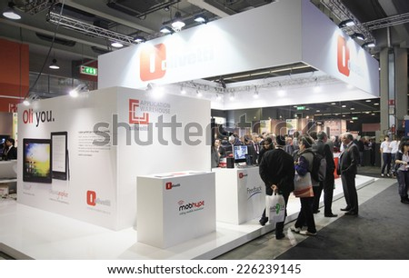 MILANO, ITALY - OCTOBER 17, 2012: People visit Olivetti technology products exhibition area at SMAU, international fair of business intelligence and information technology in Milano, Italy. - stock photo