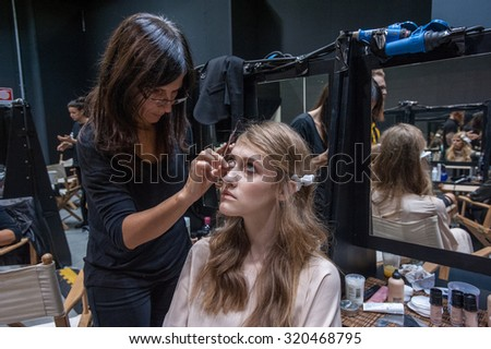MILANO, SEPTEMBER 23, 2015: a model is made up at the backstage of Simonetta Ravizza during the presentation of spring-summer 15/16 collection at Milan Fashion Week 2015. - stock photo