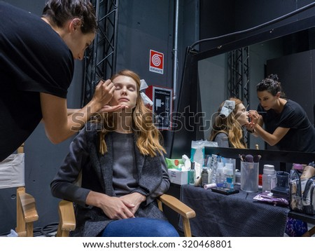 MILANO, SEPTEMBER 23, 2015: a model is made up at the backstage of Simonetta Ravizza during the presentation of spring-summer 15/16 collection at Milan Fashion Week 2015.