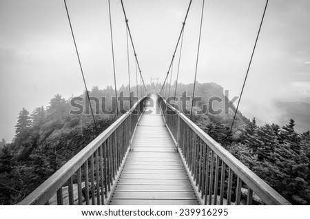 Mile High Swinging Bridge Fog Blue Ridge Mountains NC - stock photo