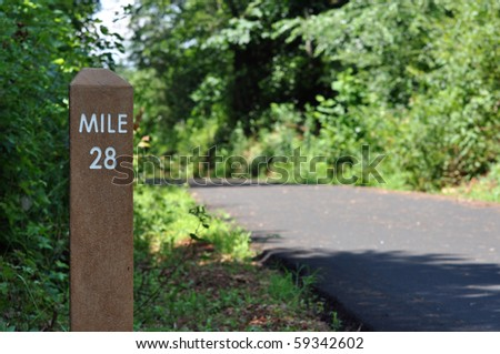 Mile marker on bike path - stock photo