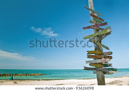 milepost on beach in key west florida - stock photo