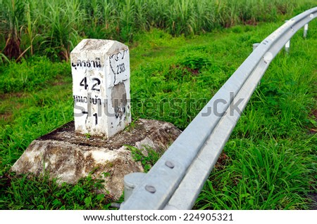milestone. a milestone, maker of a mile along the road. - stock photo