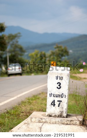 Milestone on the road to Pai, Mae Hong Son, Thailand - stock photo