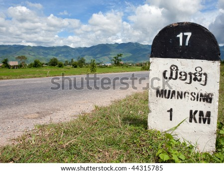 milestone to muang sing - stock photo