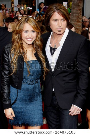 Miley Cyrus and Billy Ray Cyrus at the Los Angeles premiere of 'Hannah Montana The Movie' held at the El Capitan Theater in Hollywood on April 4, 2009.  - stock photo