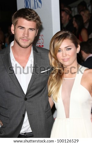 Miley Cyrus and Liam Hemsworth at the 2012 People's Choice Awards Arrivals, Nokia Theatre. Los Angeles, CA 01-11-12 - stock photo