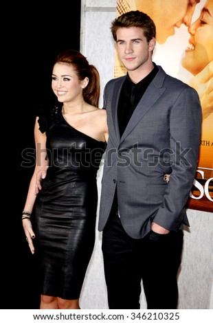 "Miley Cyrus and Liam Hemsworth at the World Premiere of ""The Last Song"" held at the ArcLight Cinemas in Hollywood, California, United States on March 25, 2010.   - stock photo"