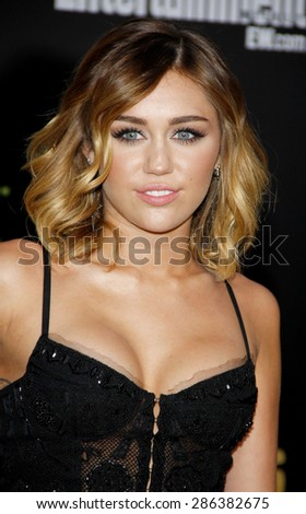 Miley Cyrus at the Los Angeles premiere of 'The Hunger Games' held at the Nokia Theatre L.A. Live in Los Angeles on March 12, 2012.  - stock photo