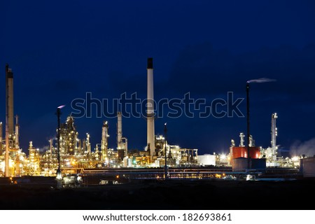 MILFORD HAVEN, UK - DECEMBER 28: Milford Havens Murco owned petrochem refinery at night on December 28, 2013 in Milford Haven. The Murco plant employs 370 people and was commissioned in 1973 - stock photo