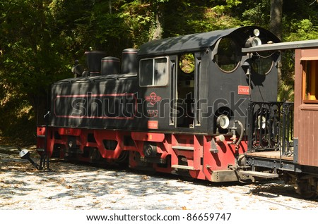 MILIES, GREECE - SEPTEMBER 25: car and loc of the nostalgic Moutzouris-Smudgy train in Milies station, a weekly tourist attraction in the Pelion mountains on September 25, 2011 in Milies, Greece - stock photo