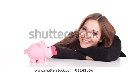 miling young woman in black blouse with pink piggy bank