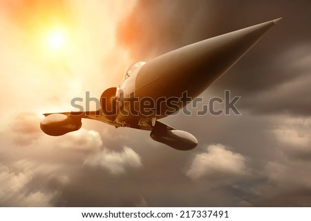 Military airplane at flying on the speed - stock photo