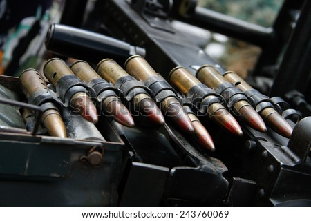 Military ammunition[ heavy machine gun bullet- sign of war today] - stock photo