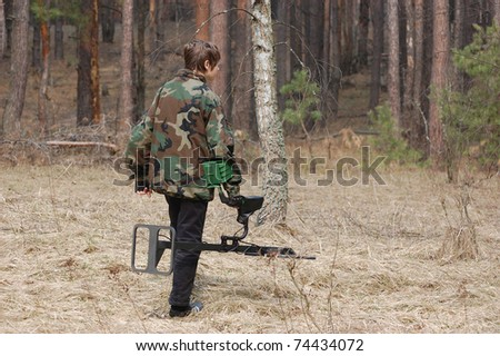 Military archeology. Boy teenager with metal detector on the battlefield of WW2.Ukraine
