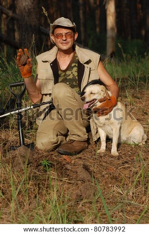 Military archeology. Man with metal detector and Soviet WWII F-1 hand-grenade. Eastern Europe - stock photo