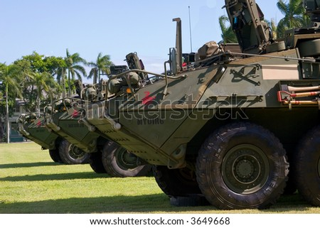 Military Army Stryker light armored brigade vehicle in a row - stock photo