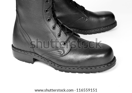 Military boots on a white background - stock photo