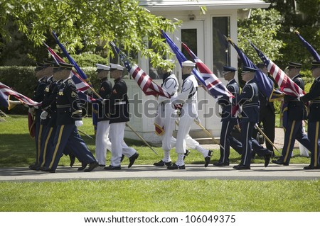 Military branches carrying the fifty state flags on May 7, 2007 at the White House, as part of the welcoming of Her Majesty Queen Elizabeth II to Washington, DC and America - stock photo