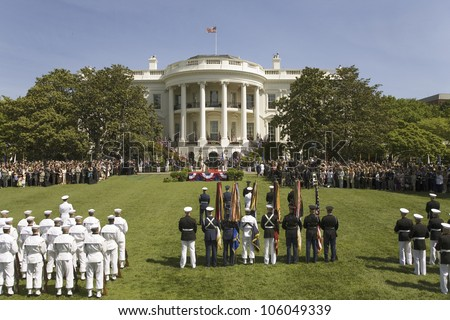 Military branches displaying flag colors on the South Lawn of the White House May 7, 2007 Official State Welcoming of Her Majesty Queen Elizabeth II and Prince Philip to Washington, DC and America - stock photo