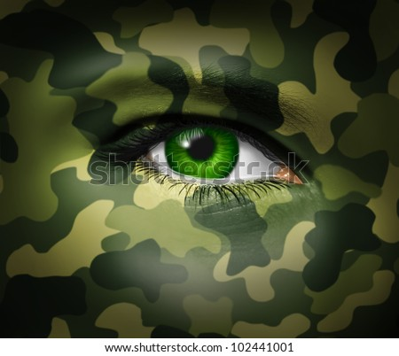 Military camouflage on a human face with a close up of the green eye gazing and looking representing war tactics and battle strategy in an army or business situation. - stock photo