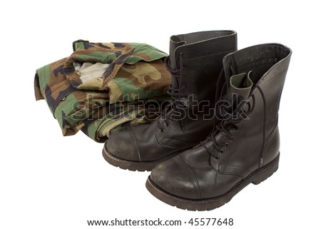 Military camouflage uniforms and boots - stock photo