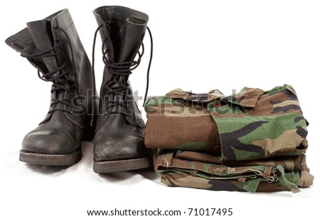 military camouflage uniforms and boots. - stock photo