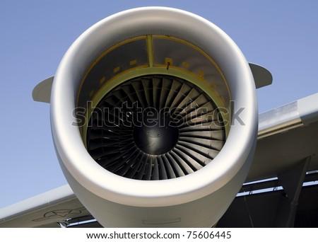 Military cargo airplane jet engine closeup - stock photo